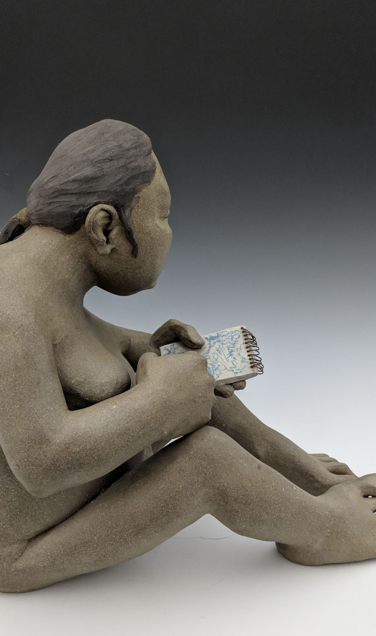Roxanne Swentzel - seated woman with notepad